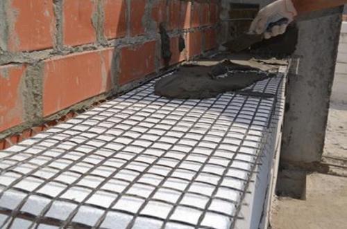 Использование базальтовой сетки для соединения пеноблоков и кирпичной облицовки