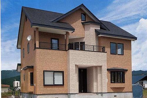 Дом облицованный фасадными фиброцементными панелями